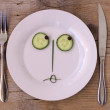 Vegetable Face on Plate - Female, sulking - Stock Photo