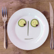 Vegetable Face on Plate - Male, Sceptical — Stockfoto