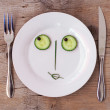 Vegetable Face on Plate - Female, Flirting - Stock Photo