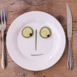 Vegetable Face on Plate - Male, Neutral, looking down - Stock Photo