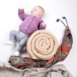 Baby on Snail - Stock Photo