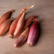 Shallots ready for use as ingredients in cooking - Stock Photo