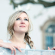 Woman daydreaming on the balcony - Stockfoto