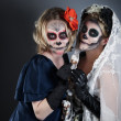 Two women in skull make-up - Stock Photo
