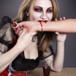 Blonde Vampire Woman - Stock Photo