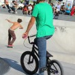 Stock Photo: BMX biker and skater in skate park