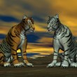 Stock Photo: Two tigers and cloudy sky