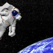 Astronaut looking at the earth - 3D render - Stock Photo