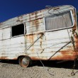 Dusty abandonned old caravan - Stock Photo