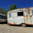 Stock Photo: Dusty abandonned old caravans