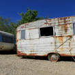 Dusty abandonned old caravans — Stock Photo