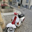 Scooter in old city, Estavayer-le-lac, Switzerland — Stock Photo #28811755