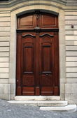 Old wooden door, Geneva, Switzerland — Stock Photo