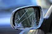 Damaged rearview mirror on a car — Stock Photo