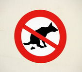 No pooping by dogs sign — Stock Photo
