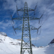 Electric pylon in the mountain — Stockfoto