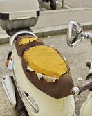 Damaged seat of scooter — Stock Photo
