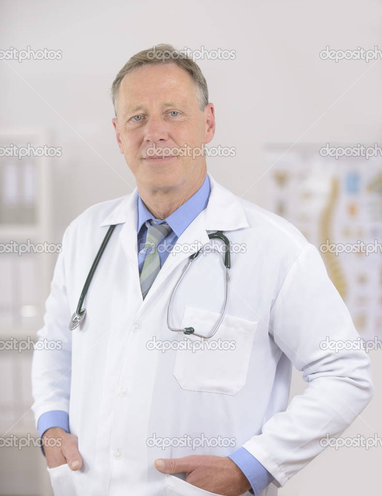 Portait of a mature male doctor at office — Stok fotoğraf #12298368