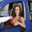 Woman receiving keys of her new car — Stock Photo