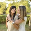 Lesbian girl hugging her girlfriend - Stock Photo