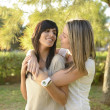 Lesbigirl hugging her girlfriend — Stock Photo #15545987