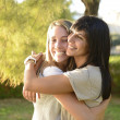 Lesbian couple hugging - Stock Photo