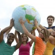 Group of young holding a globe earth — Stock Photo
