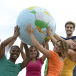 Group of young holding a globe earth - Stock Photo