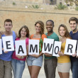 Group of young holding teamwork sign — Stock Photo