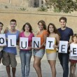 Foto de Stock  : Happy and diverse volunteer group