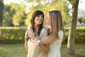 Lesbian girl hugging her girlfriend — Stock Photo