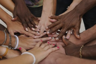 Many hands together: group of joining hands