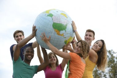 Group of young holding a globe earth
