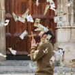 Man praying and money falling from the sky — Stock Photo #21500799