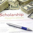 Scholarship application form and money - Stock Photo