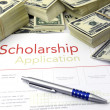 Stock Photo: Scholarship application form and money