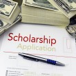 Scholarship application form and money — Stock Photo