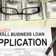 Stock Photo: Approved small business loan application form and money