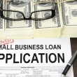 Stock Photo: Approved small business loapplication form and money