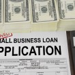 Approved small business loan application form and money — Stock Photo