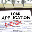 Approved loan application form and dollar bills — Stock Photo #21501229
