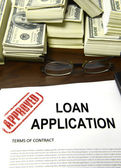 Approved loan application and dollar bills — Stock Photo