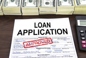 Approved loan application form and dollar bills — Stock Photo