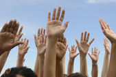 Hands Up against blue sky — Stock Photo
