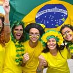Group of happy brazilian soccer fans — Stock Photo