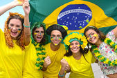 Group of happy brazilian soccer fans — Stock Photo