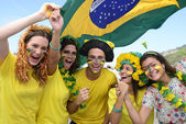 Group of happy brazilian soccer fans — 图库照片