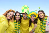 Happy brazilian soccer fans commemorating victory — Stock Photo