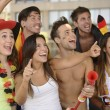 Enthusiastic German sport soccer fans — Stock Photo
