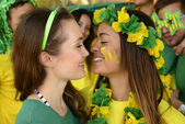 Girlfriends soccer fans almost kissing each other. — Stock Photo